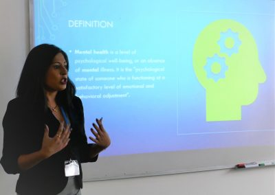 A photo of Monica from West Midlands Employers presenting in front of a screen
