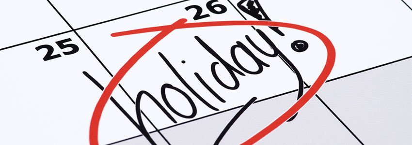 Close up of a calendar with 'holiday' highlighted and ringed