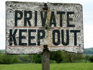 a wooden 'private, keep out' sign