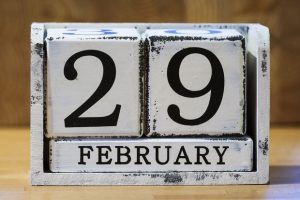 A wooden calendar showing February 29 as the date